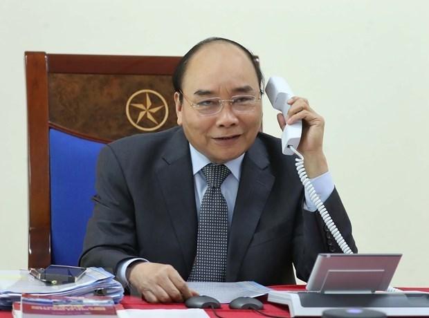 Premier vietnamita mantiene conversaciones telefonicas con homologos de Laos y Camboya hinh anh 1
