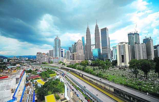 Revisa Banco Mundial previsiones de crecimiento a la baja para Filipinas y Malasia hinh anh 1