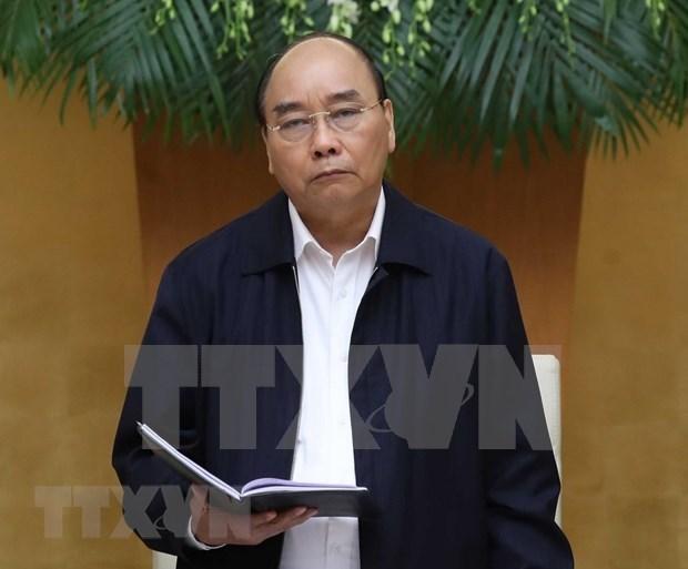 Premier de Vietnam reitera prioridad concedida a grupos vulnerables ante el COVID-19 hinh anh 1