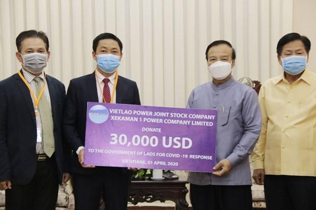 Empresa vietnamita apoya Laos contra COVID-19 hinh anh 1