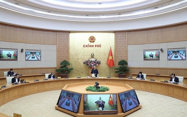 Gobierno vietnamita debate garantia del bienestar social para personas afectadas por COVID- 19 hinh anh 1