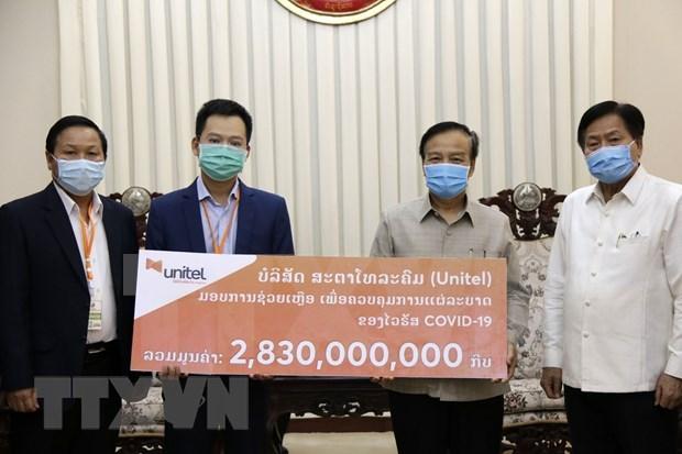 Apoyan empresas vietnamitas a Laos en enfrentamiento al COVID-19 hinh anh 1