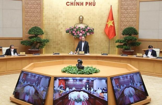 Premier vietnamita pide medidas urgentes para paliar impacto de COVID-19 hinh anh 1