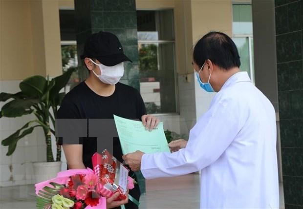 Recuperados en Vietnam otros cuatro pacientes de COVID-19 hinh anh 1