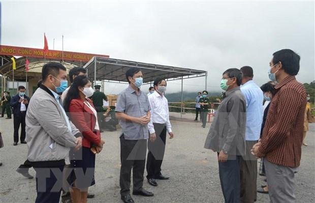 Provincias vietnamitas y laosianas mejoran coordinacion en lucha contra el COVID-19 hinh anh 1