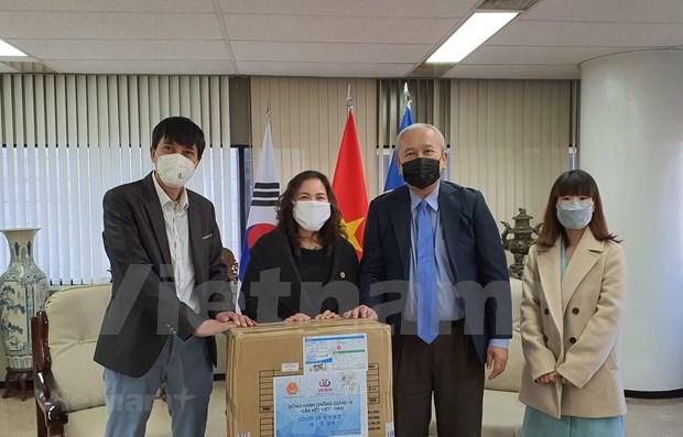 Donan mascarillas a vietnamitas residentes en Corea del Sur hinh anh 1