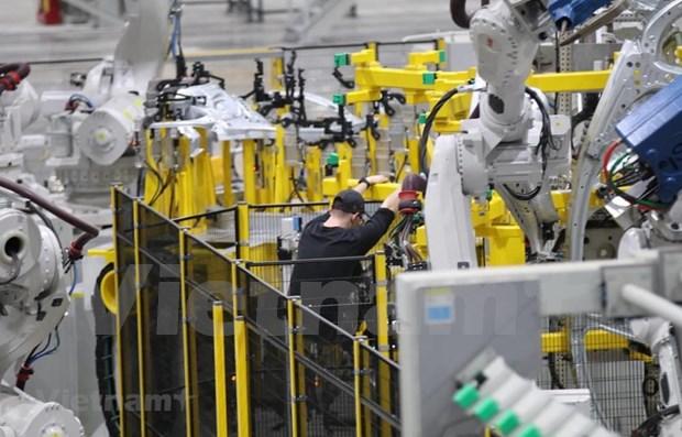 "Fitch revisa perspectiva economica de Vietnam a ""estable"" hinh anh 1"