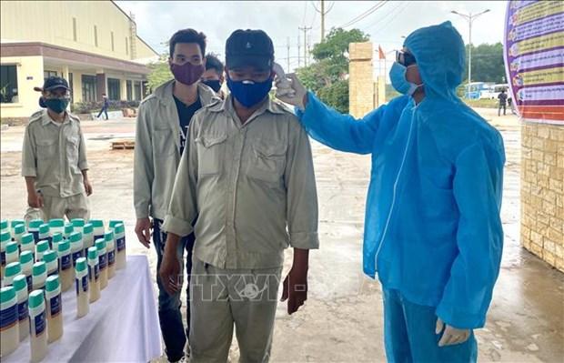 Piden controlar la expansion de COVID-19 entre trabajadores vietnamitas hinh anh 1