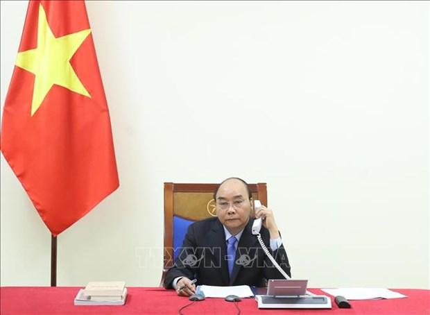 Premieres de Vietnam y la India evaluan cooperacion binacional para repeler el COVID-19 hinh anh 1