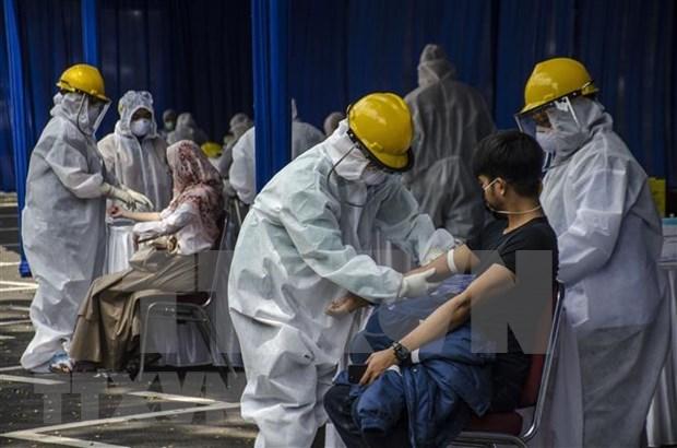Cumbres de ASEAN y socios, simbolo de solidaridad regional en era de pandemia hinh anh 1