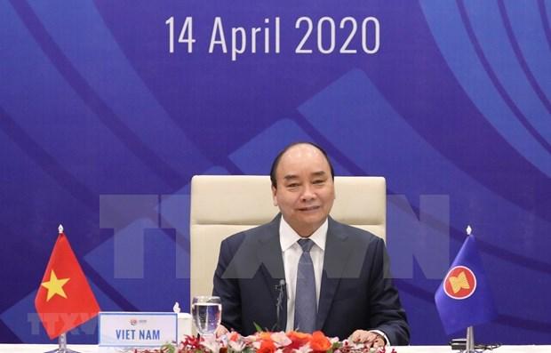 Premier vietnamita reitera importancia de solidaridad en la ASEAN para enfrentar el COVID-19 hinh anh 1