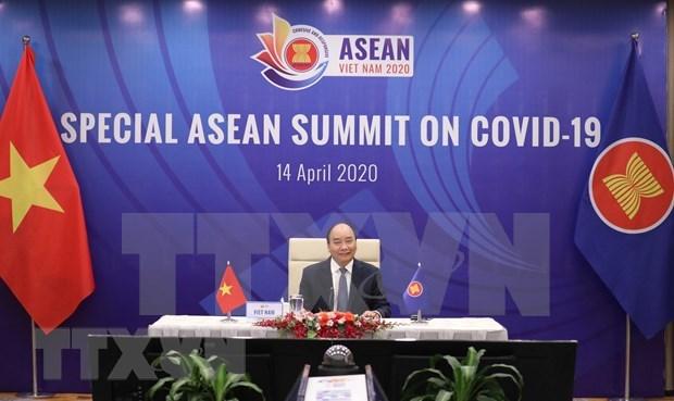 ASEAN promueve cooperacion en lucha contra el COVID-19 hinh anh 1