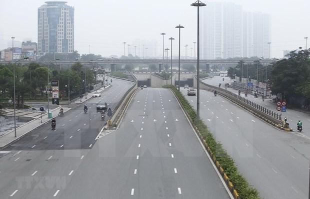 Premier vietnamita prolonga medidas de distanciamiento social en 12 localidades hinh anh 1