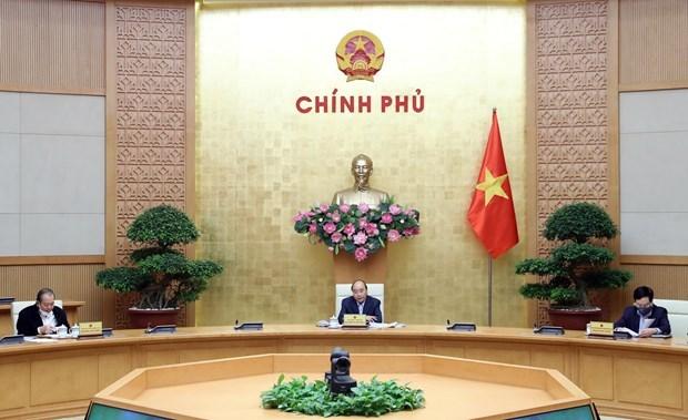 Premier vietnamita enfatiza importancia de fluidez economica en combate contra pandemia hinh anh 1
