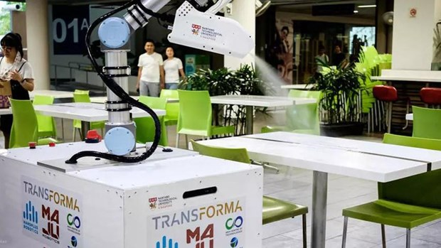 Singapur prueba robot desinfectante en lucha contra coronavirus hinh anh 1