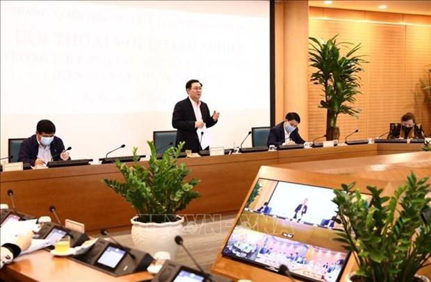 Autoridades de Hanoi dialogan con empresas hinh anh 1