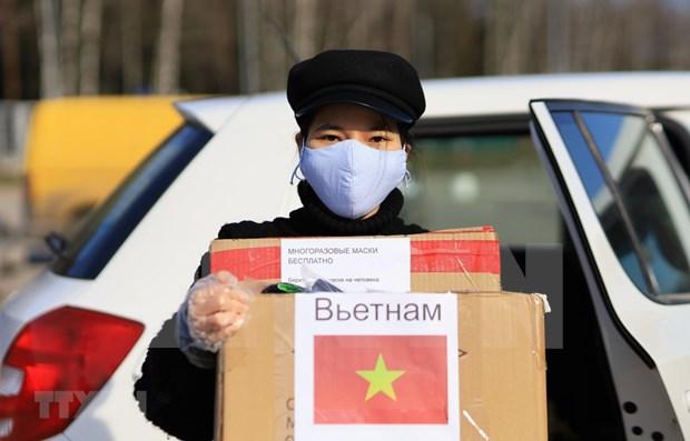 Llaman a vietnamitas en Rusia a incorporarse al combate contra COVID-19 hinh anh 1