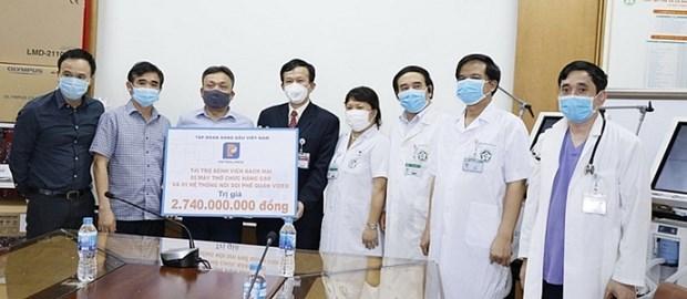 Grupo Nacional de Petroleo de Vietnam suma esfuerzos contra el COVID-19 hinh anh 1