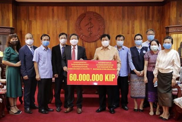 Vietnam acompana a Laos en lucha contra COVID -19 hinh anh 1
