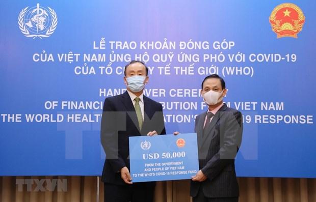 Entregan asistencia financiera de Vietnam al Fondo contra COVID- 19 de OMS hinh anh 1