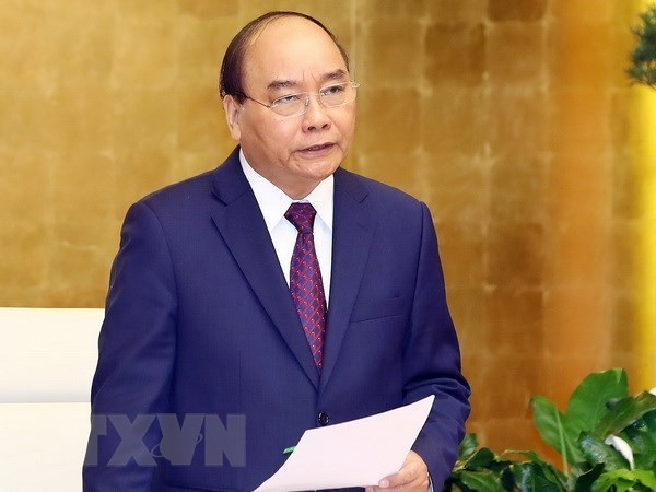 Premier vietnamita ordena la continuacion de medidas contra COVID-19 en nuevo contexto hinh anh 1