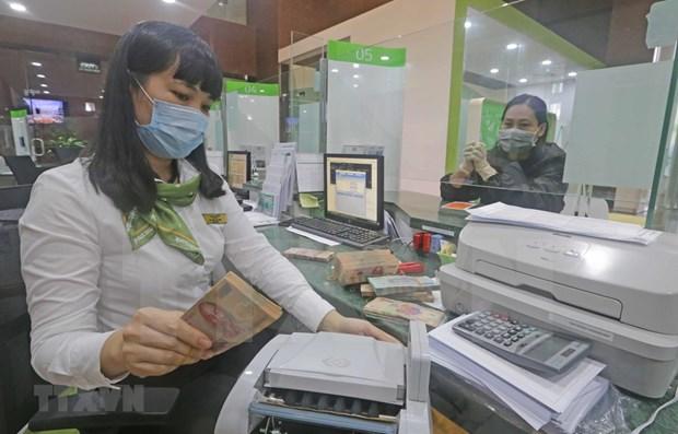 Bancos vietnamitas reportan ganancias en primer trimestre del ano hinh anh 1