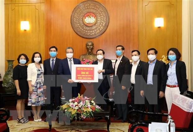 Vietnamitas en Corea del Sur y Tailandia respaldan a lucha contra COVID-19 en pais de origen hinh anh 1