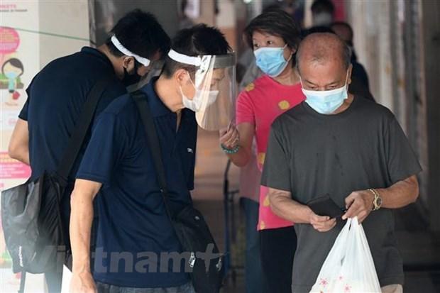 Suaviza Singapur las restricciones de prevencion del COVID-19 hinh anh 1
