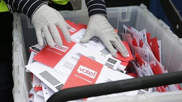 Indonesia pospone oficialmente elecciones regionales debido a COVID-19 hinh anh 1