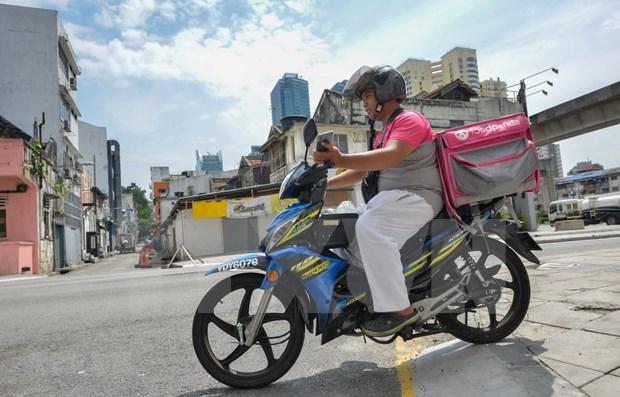 Reduce Malasia tasa de interes bancaria ante la epidemia de COVID -19 hinh anh 1
