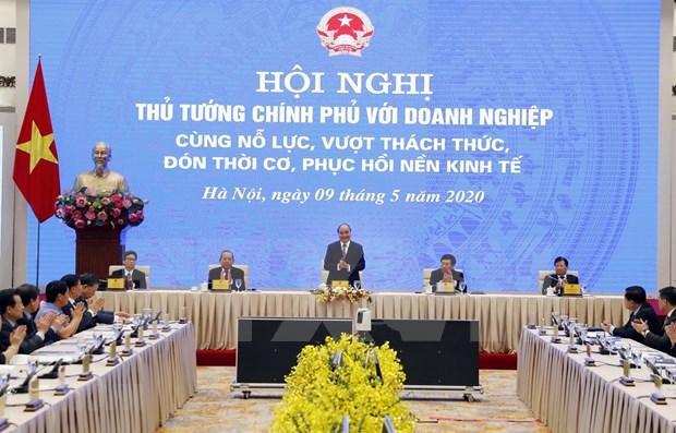 Vietnam se esfuerza por promover economia y superar impactos de pandemia hinh anh 1