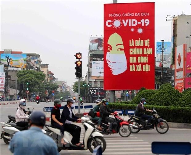 Partido Comunista y Estado de Vietnam con alta confianza del publico en lucha antiepidemica, dice sondeo global hinh anh 1