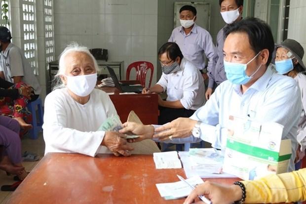 Hanoi continua apoyando a pobladores afectados por COVID- 19 hinh anh 1