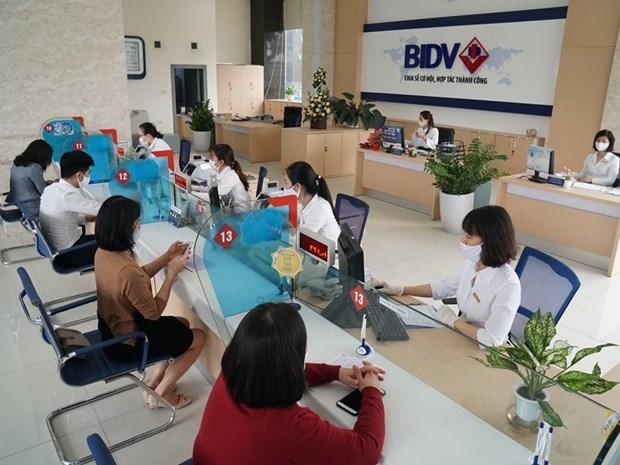 Estrechan lazos entre bancos y empresas para superar dificultades en produccion hinh anh 1