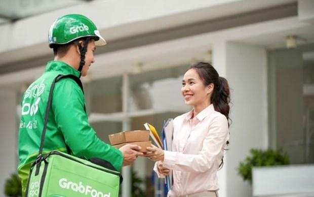 Bancos de Indonesia implementan programa crediticio para conductores de Grab hinh anh 1