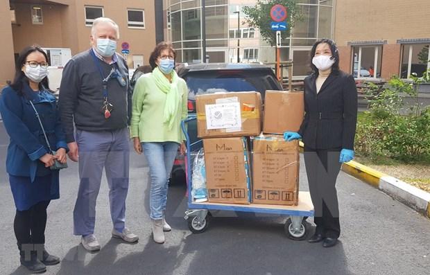 Ciudadana vietnamita brinda aportes a la lucha contra COVID -19 en Belgica hinh anh 1