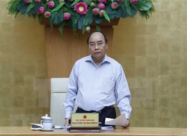 Insta premier vietnamita a continuar fortaleciendo medidas antiepidemicas para garantizar el desarrollo socioeconomico hinh anh 1