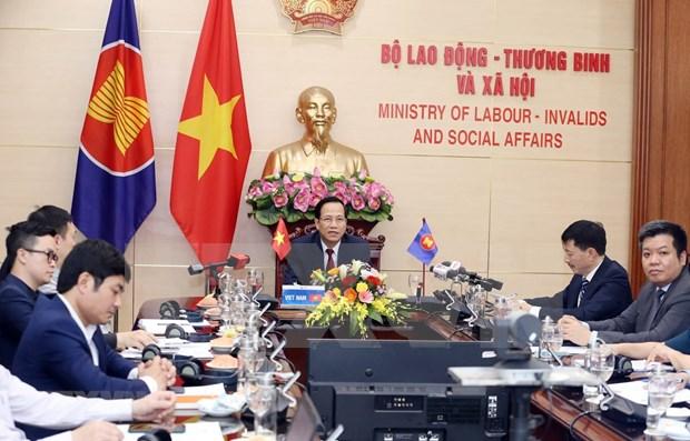 Comparte Vietnam experiencias en respaldo a empleados ante impactos de pandemia hinh anh 1
