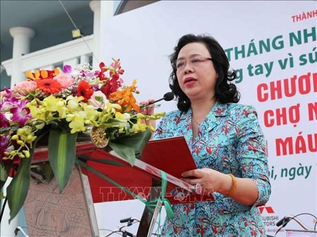 Apoya Cruz Roja de Hanoi a pobladores con dificultades economicas hinh anh 1