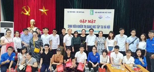Actividad en respaldo a estudiantes con ceguedad y deficiencia visual en Hanoi hinh anh 1