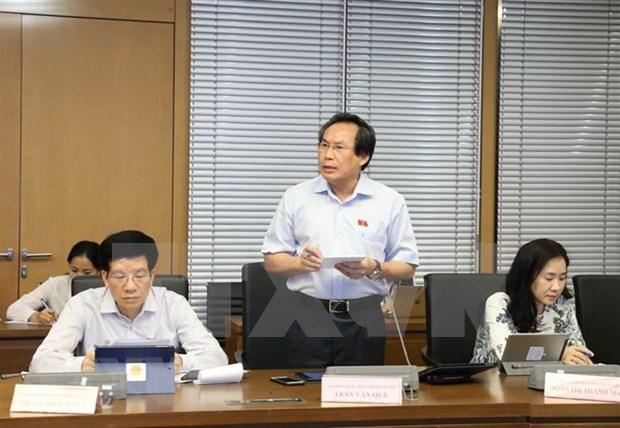 Parlamento analiza Ley de trabajadores vietnamitas en el extranjero hinh anh 1