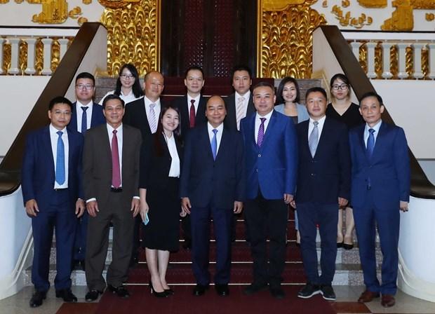 Dialoga premier de Vietnam con empresarios chinos hinh anh 1