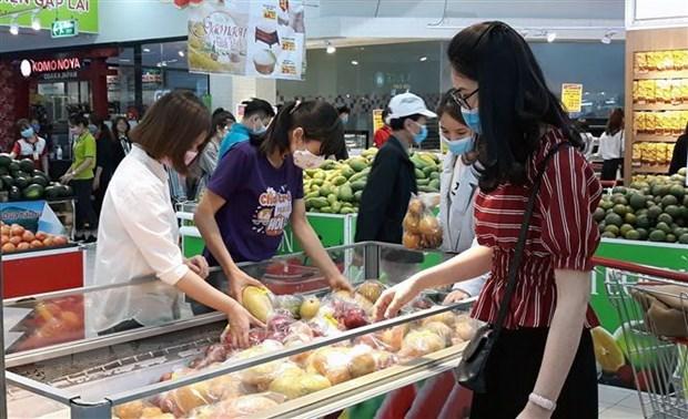 Comerciantes vietnamitas enfrentan dificultades para mantener espacio comercial hinh anh 1