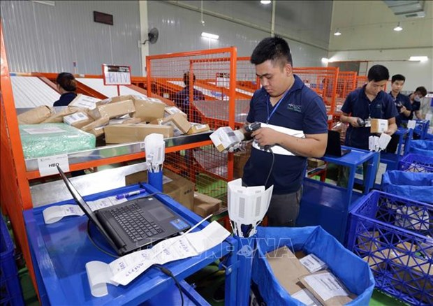 Vietnam busca adaptar al nuevo modelo de negocio en etapa postpandemia hinh anh 1