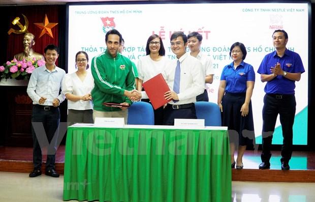 Union juvenil y Nestle Vietnam cooperan en favor de ninos de escasos recursos hinh anh 1