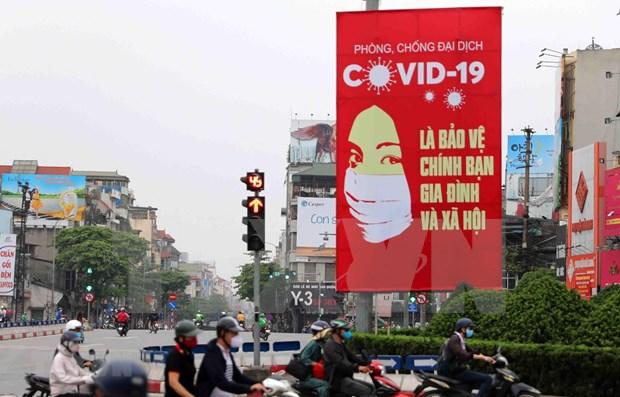 Experto ruso destaca eficiencia de uso de carteles en combate antiepidemico en Vietnam hinh anh 1
