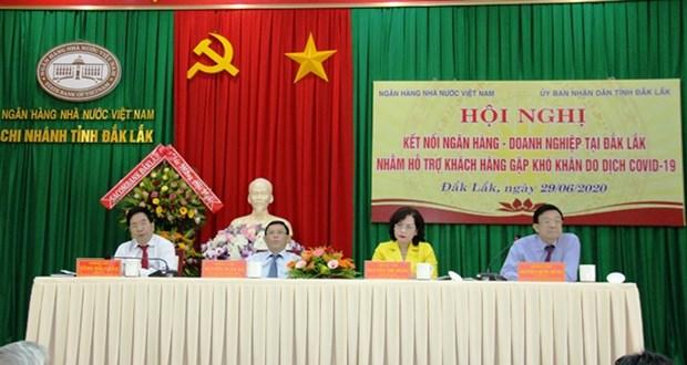 Banco estatal de Vietnam asiste a empresas afectadas por el COVID-19 hinh anh 1