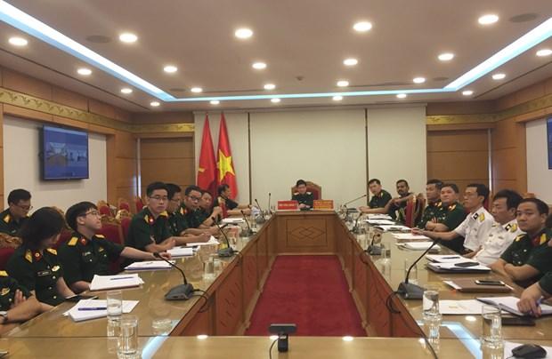 Medicos militares de Vietnam e India comparten experiencias en control el COVID-19 hinh anh 1