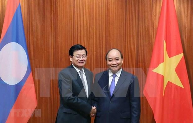 Realiza primer ministro de Laos visita a Vietnam hinh anh 1