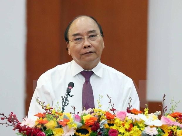 Premier de Vietnam insta al sector financiero a apoyar la restauracion economica hinh anh 1